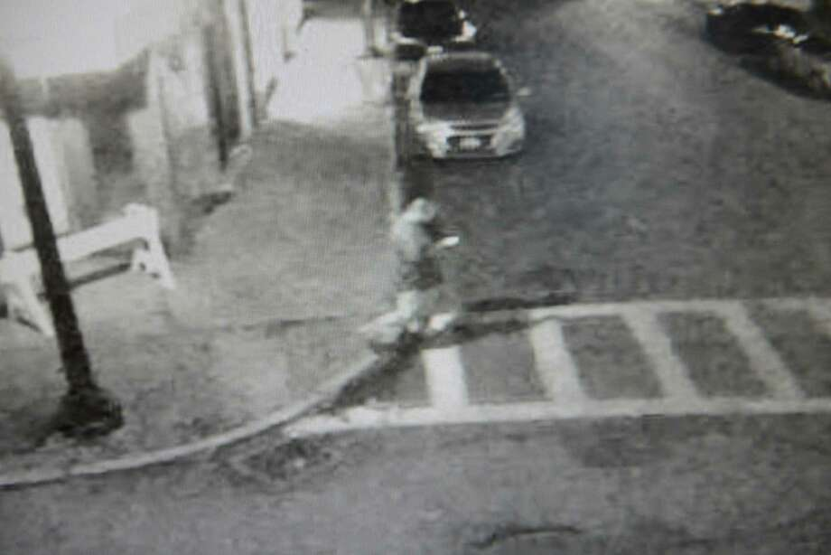 Cohoes police released a surveillance video showing a man walking on Remsen and White street at 1:30 a.m. Monday after an early-morning fire nearby. (Image provided by Cohoes Police Department)