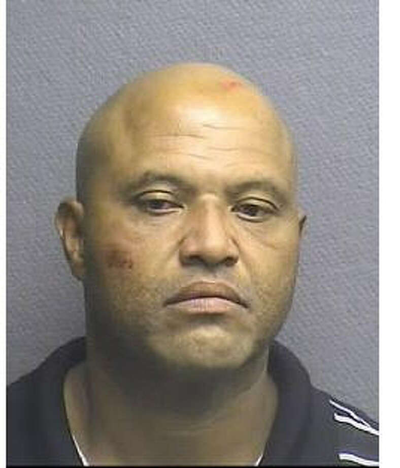 Roy Peet, 46, is accused of strangling a neighbor with a necktie, Oct. 6, 2014. (Houston Police Department)