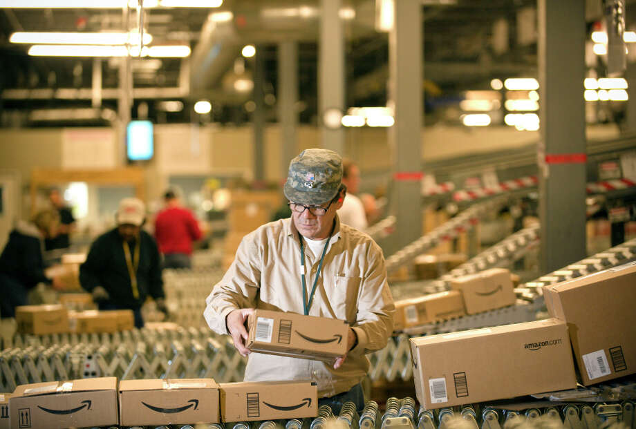 Amazon workers at this warehouse in Fernley, Nev., say they spend as long as 25 minutes waiting at security checkpoints. Photo: Scott Sady / Associated Press / FR78397 AP
