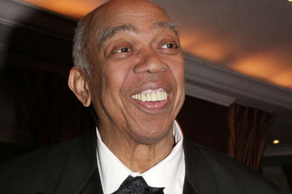 "FILE - In this March 10, 2005 file photo, Geoffrey Holder poses at the French Institute Alliance Francaise' ""La Nuit des Etoiles"" dinner  in New York, honoring French actress Catherine Deneuve. Holder, a Tony Award-winning director, actor, painter and choreographer who during an eclectic show business career led the groundbreaking show ""The Wiz"" to Broadway, pitched 7-Up soda on TV and played a scary villain in the James Bond film ""Live and Let Die,"" died Sunday of complications of pneumonia at Mount Sinai St. Luke' s Hospital in New York. He was 84. (AP Photo/Tina Fineberg, File)"