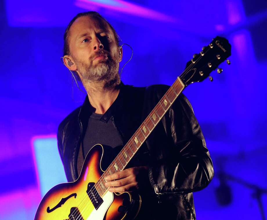 """FILE - In this Oct. 6, 2013 file photo, Thom Yorke performs at the 2013 Austin City Limits Music Festival in Austin Texas. Yorke is making an end run around """"the self elected gate-keepers"""" and putting out a new solo album using BitTorrent instead of traditional distribution methods. Yorke and his producer Nigel Godrich issued a letter through their publicist Friday, Sept. 26, 2014, announcing the album, called """"Tomorrow's Modern Boxes."""" The $6 download includes eight songs and a video. (Photo by John Davisson/Invision/AP, File) ORG XMIT: NYET501 Photo: John Davisson / Invision"""