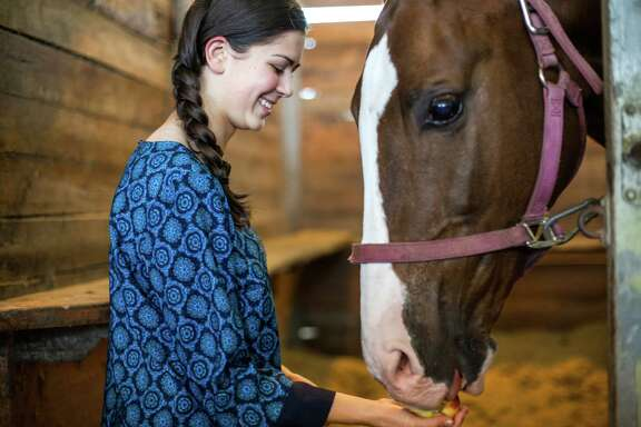 Kara Hachigian, 16, interacts with one of her horses, Hoops, at Bluebonnet Farms Saturday September 13, 2014 in Bellville, TX. (Michael Starghill, Jr.)