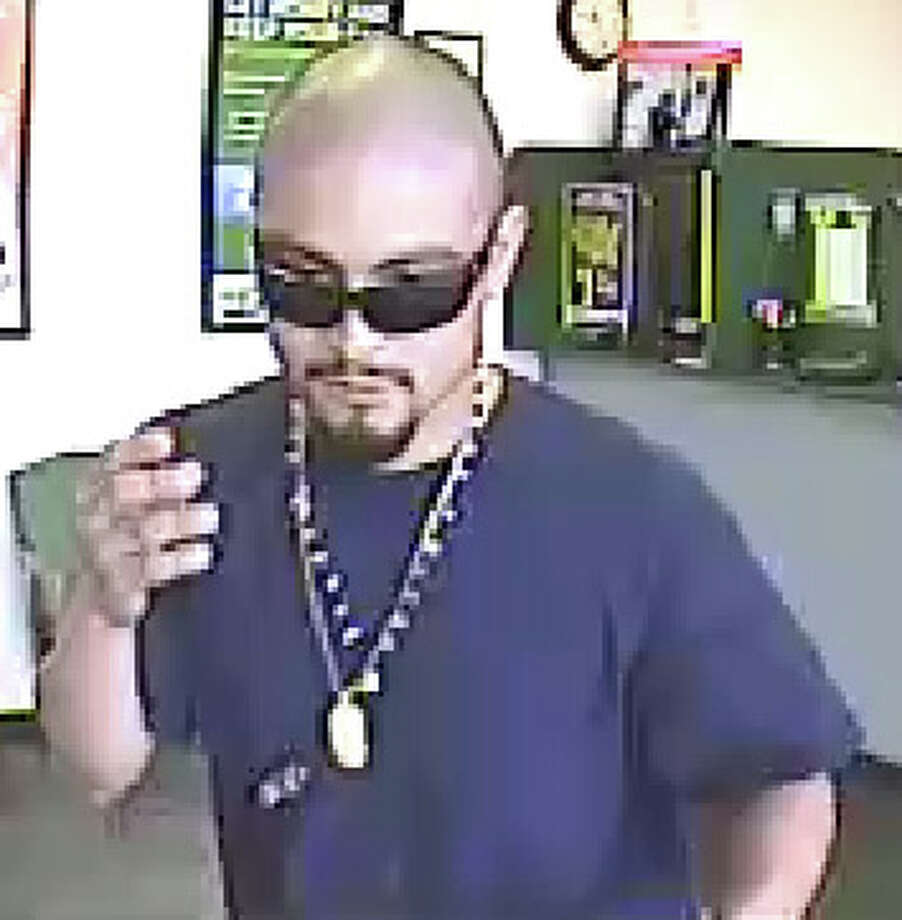 Crime Stoppers of Houston say this man robbed an EZ Loan at gunpoint on Sept. 8, 2014. Photo: Crime Stoppers Of Houston