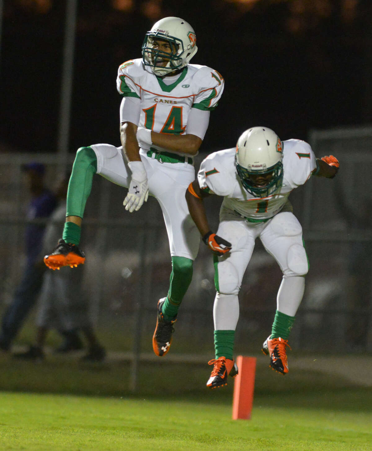 Sam Houston's Jawon Anderson (14) jumps for joy after scoring a touchdown with teammate Travon Vaughns during their game against Brackenridge Friday night.