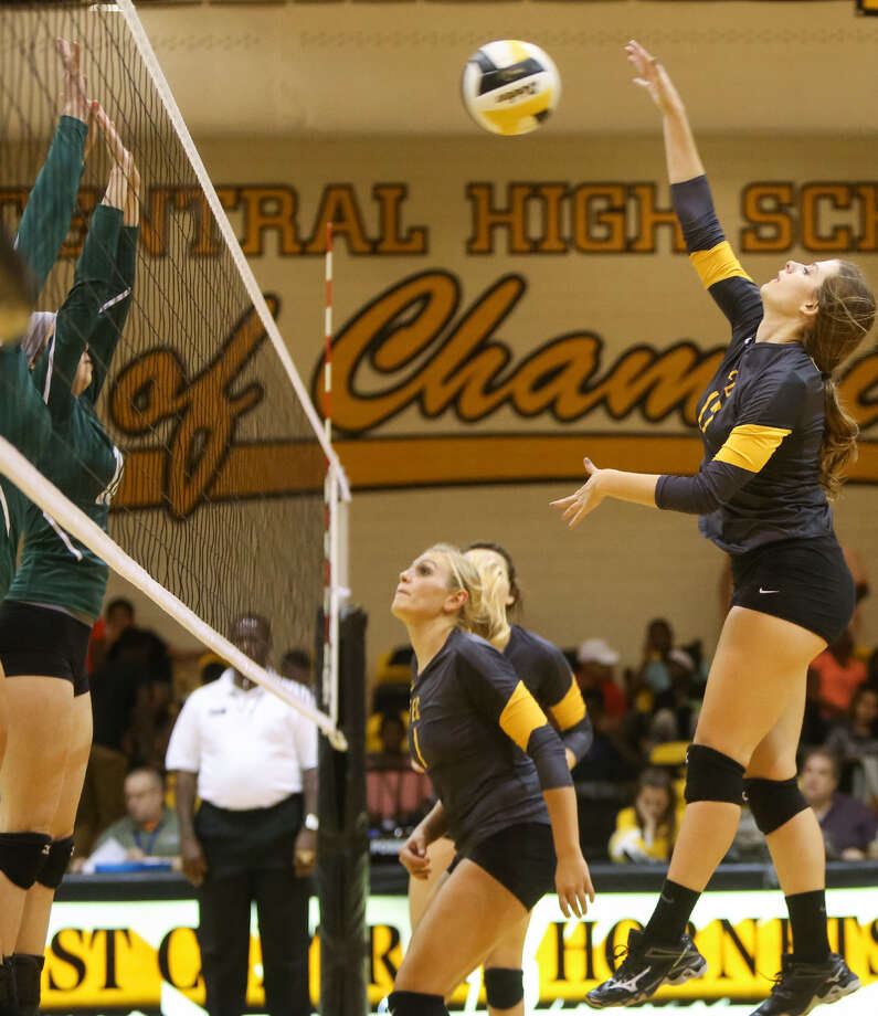 East Central's Madison Simon (right), hits the ball across the net during the Hornets' match with Southwest at East Central on Sept. 30. Photo: Marvin Pfeiffer / Southside Reporter / EN Communities 2014