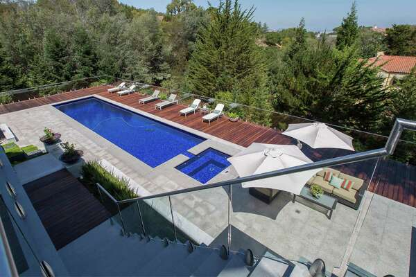 Hillsborough estate blends contemporary flair with resort style living for Hillsborough swimming pool prices