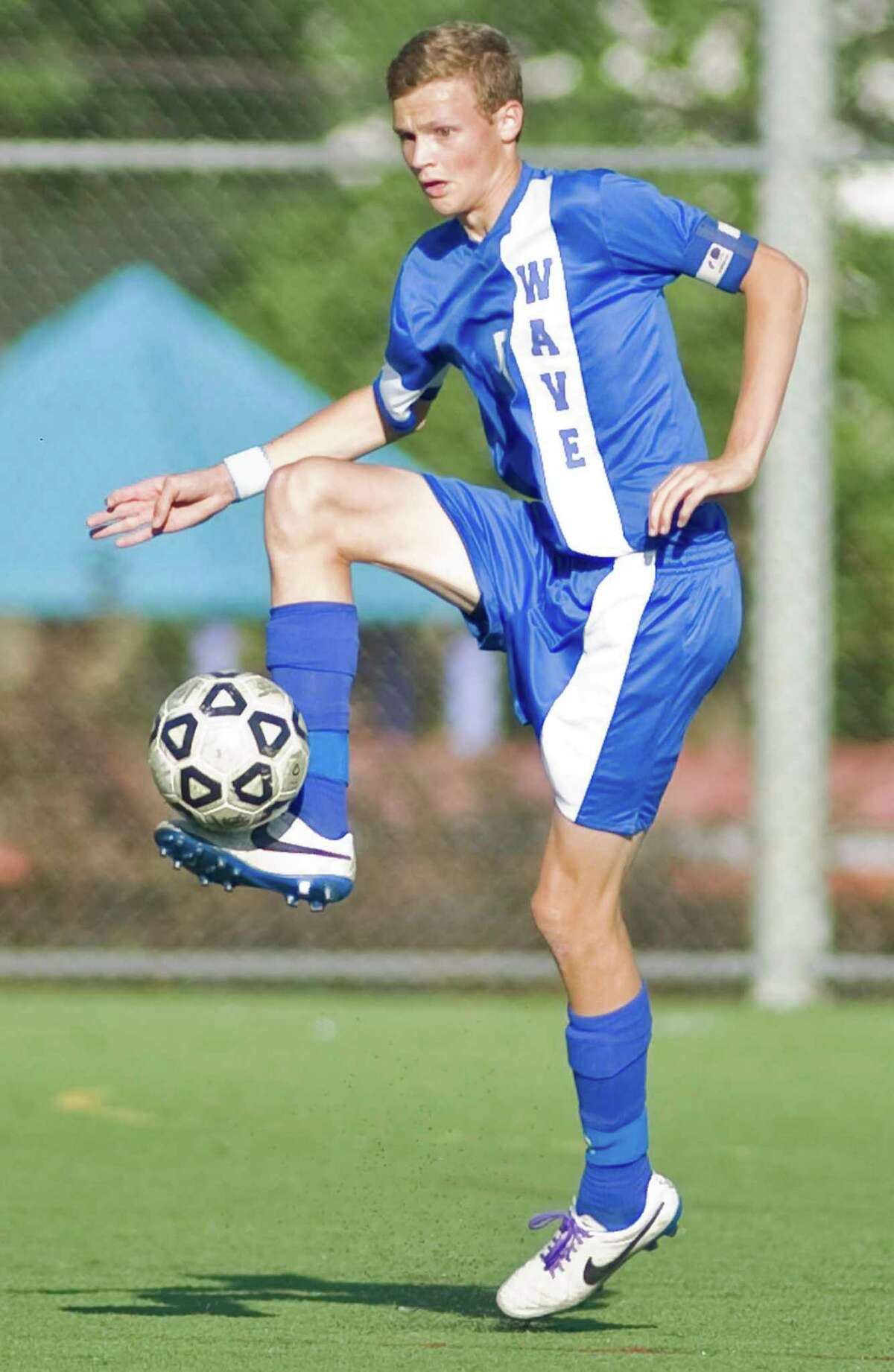 Darien High School's John Mackie catches the ball during a game against Stamford High School, played at Stamford. Monday, Oct. 6, 2014