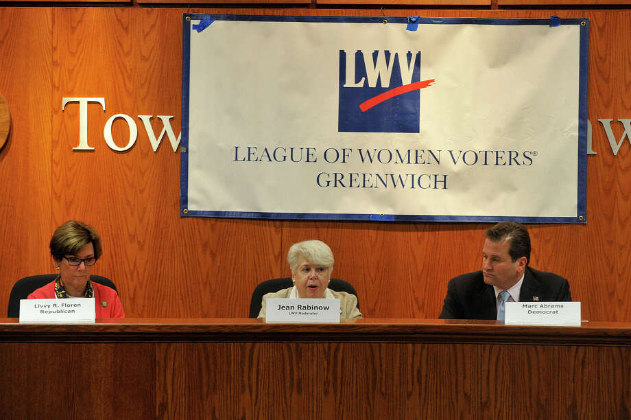 Jean Rabinow, center, a Bridgeport League of Women Voters member, moderates candidates for State Representative in the 149th District incumbent Republican Livvy Floren, left, and Democratic challenger Marc Abrams spar during the Greewich League of Women Voters' political debate at the Town Hall in Greenwich, Conn., on Monday, Oct. 6, 2014. Photo: Jason Rearick / Stamford Advocate