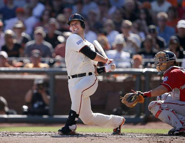 Giants Buster Posey swings and misses in the first inning during game 3 of the NLDS at ATT Park on Monday, Oct. 6, 2014 in San Francisco, Calif.