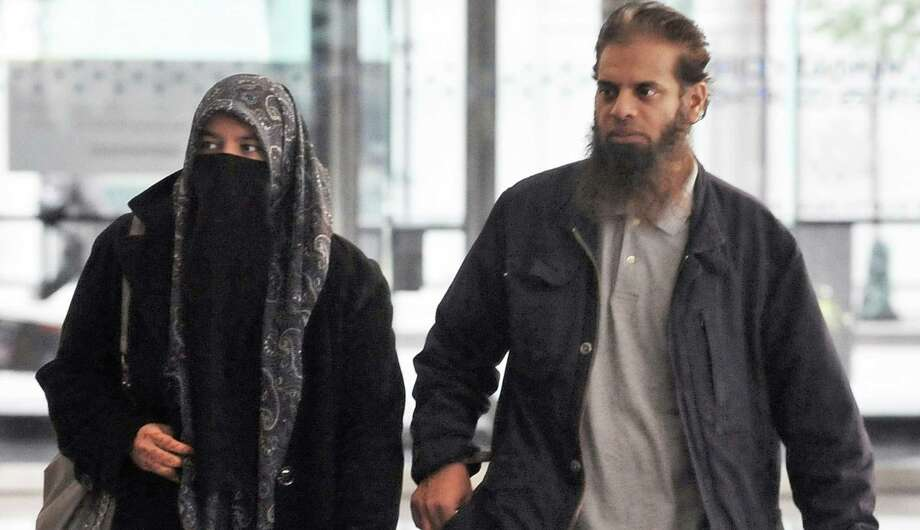 The parents of Mohammed Hamzah Khan, a 19-year-old U.S. citizen from Bolingbrook, Ill., leave the Dirksen federal building in Chicago. Their son was arrested Saturday at O'Hare airport in Chicago. Photo: Al Podgorski / Associated Press / Sun-Times Media