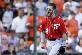 Bryce Harper #34 of the Washington Nationals celebrates after scoring on a throwing error by Madison Bumgarner #40 of the San Francisco Giants in the seventh inning during Game Three of the National League Division Series at AT&T Park on October 6, 2014 in San Francisco, California.  (Photo by Ezra Shaw/Getty Images)