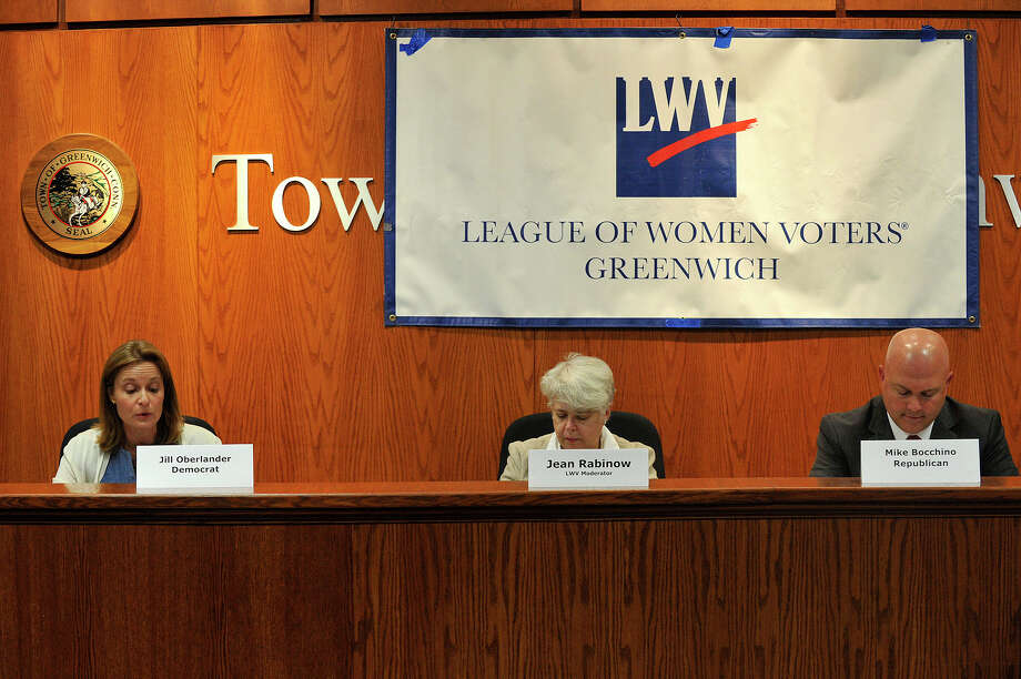 Candidates for State Representative in the 150th District Democrat Jill Oberlander, left, spars with Republican Mike Bocchino during the Greewich League of Women Voters' political debate at the Town Hall in Greenwich, Conn., on Monday, Oct. 6, 2014. The two are vying for the seat vacated by State Rep. Stephen Walco. Jean Rabinow, a Bridgeport League of Women Voters member, was the moderator. Photo: Jason Rearick / Stamford Advocate