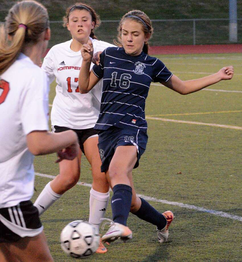 Immaculate High Schools Mackinsey Jarboe has possession of the ball during a game against Pomperaug at Pomperraug on Monday, October 6, 2014. Photo: Lisa Weir / The News-Times Freelance
