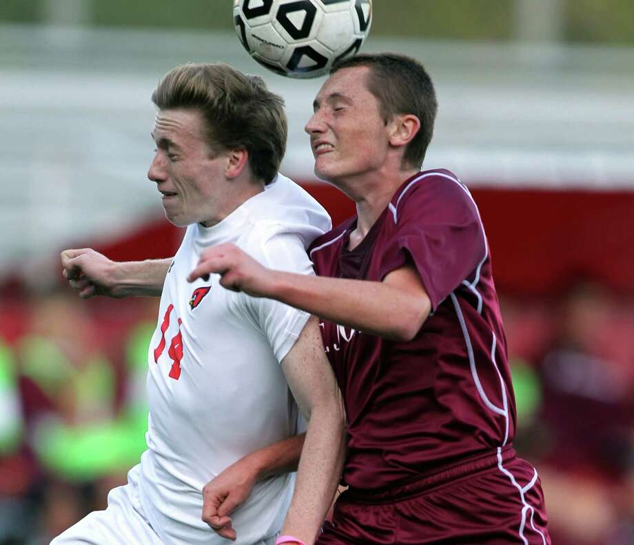 Greenwich High School defender Liam Tracey controls a loose ball against a St. Joe's striker during FCIAC soccer action at Greenwich Monday Oct. 6, 2014. Photo: J. Gregory Raymond / Stamford Advocate Freelance;  © J. Gregory Raymond