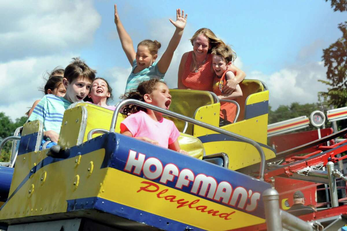 Children and their families scream as round a curve on the roller coaster on Friday, Aug. 29, 2014, at Hoffman's Playland in Latham N.Y. (Cindy Schultz / Times Union)