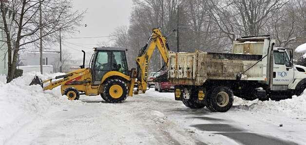 City crews use heavy equipment to clear snow along 110th Street Tuesday Feb. 18, 2014, in Troy, N.Y.  (John Carl D'Annibale / Times Union) Photo: John Carl D'Annibale / 00025810A