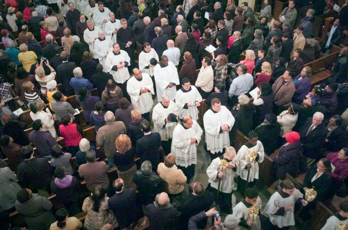 Priests process out of the church during the inauguration ceremonies for the Basilica of St. John the Evangelist in downtown Stamford, Conn. on Monday, Feb. 22, 2010. The church was officially designated by Pope Benedict XVI as a minor basilica, making it the second minor basilica in the state after the Basilica of the Immaculate Conception in Waterbury.