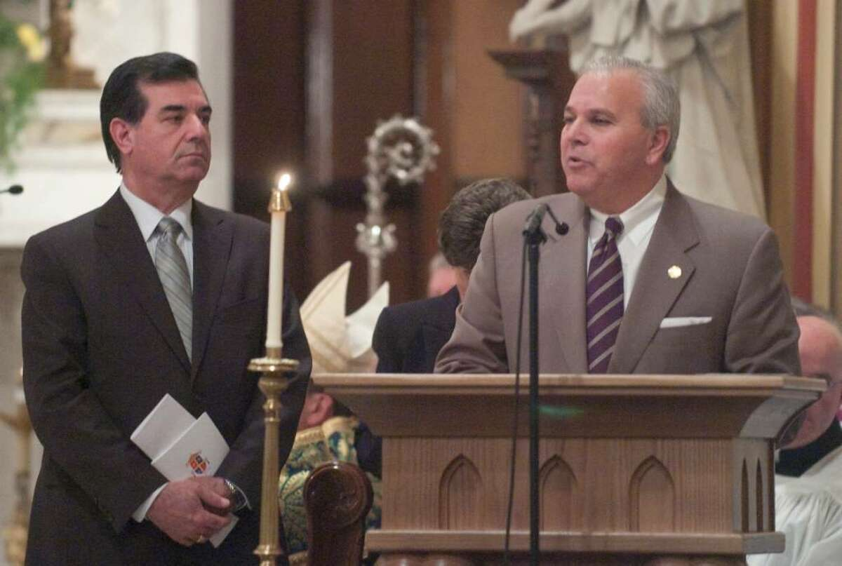 Stamford Mayar Michael Pavia, left, and Lt. Gov. Michael Fedele, right, speak during the inauguration ceremonies for the Basilica of St. John the Evangelist in downtown Stamford, Conn. on Monday, Feb. 22, 2010. The church was officially designated by Pope Benedict XVI as a minor basilica, making it the second minor basilica in the state after the Basilica of the Immaculate Conception in Waterbury.
