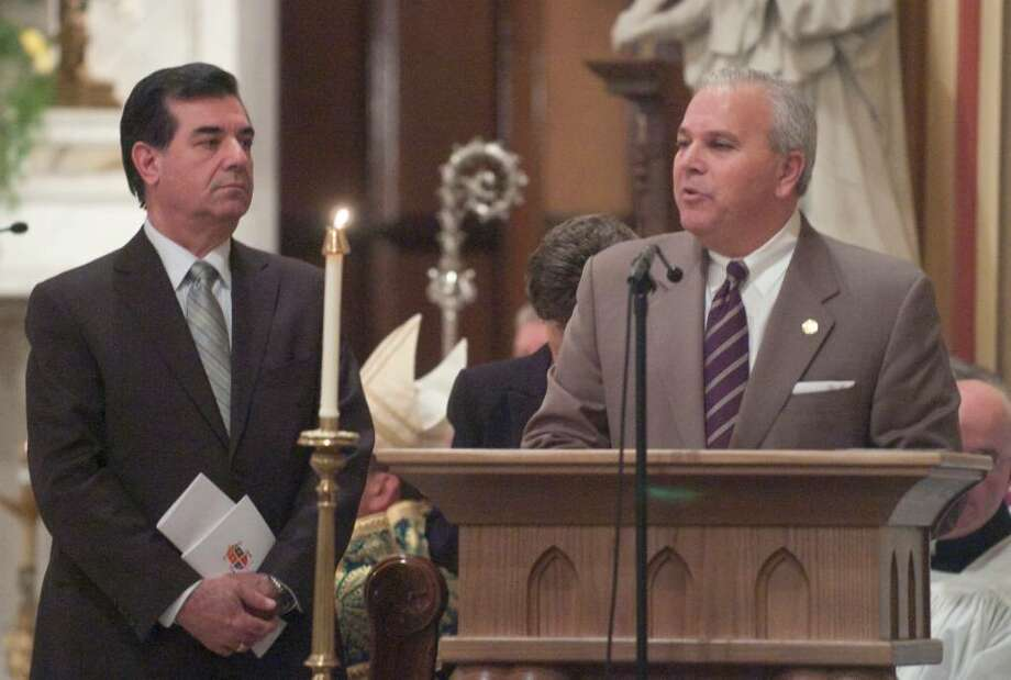 Stamford Mayar Michael Pavia, left, and Lt. Gov. Michael Fedele, right, speak during the inauguration ceremonies for the Basilica of St. John the Evangelist in downtown Stamford, Conn. on Monday, Feb. 22, 2010. The church was officially designated by Pope Benedict XVI as a minor basilica, making it the second minor basilica in the state after the Basilica of the Immaculate Conception in Waterbury. Photo: Chris Preovolos / Stamford Advocate