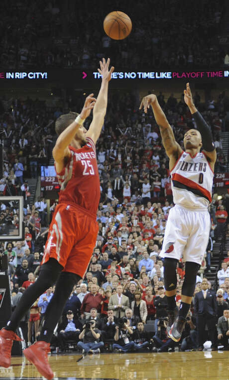 The Trail Blazers' Damian Lillard watches his winning shot against the Rockets' Chandler Parsons during Game 6 of a Western Conference first-round series last season. Lillard, an All-Star, averaged 20.7 points per game. Photo: Greg Wahl-Stephens / Associated Press / FR29287 AP