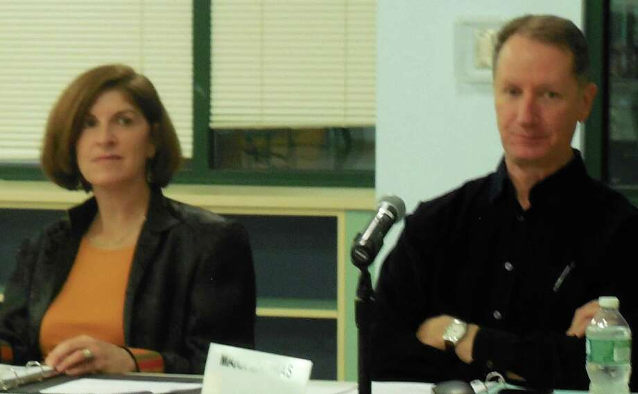 Board of Education members Brett Aronow, left, and Mark Mathias listen to comments during Monday's meeting in Staples High School. Photo: Anne M. Amato / westport news