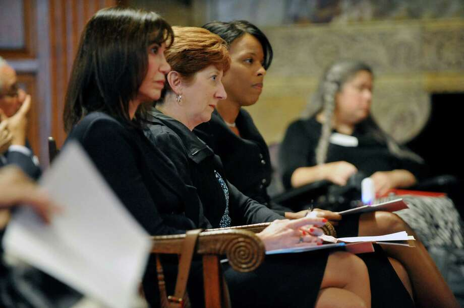 Judge Gail Prudenti, left, chief administrative judge, New York State Unified Court System, Albany Mayor Kathy Sheehan, center, and Corinda Crossdale, director of the New York State Office for the Aging wait to testify during a hearing on Civil Legal Services in the State at Court of Appeals on Monday, Oct. 6, 2014, in Albany, N.Y. The hearing was held to look at the unmet civil legal services needs of lower-income New Yorkers.  (Paul Buckowski / Times Union) Photo: Paul Buckowski / 10028897A