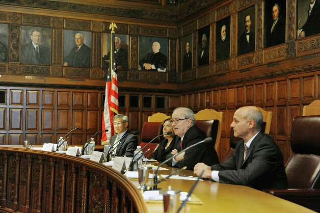 Glenn Lau-Kee, left, president of the New York State Bar Association, Judge Karen Peters, second from left, presiding justice, Chief Justice Jonathan Lippman, third from left, and Judge Lawrence Marks, first deputy chief administrative judge, hold a hearing on Civil Legal Services in the State at Court of Appeals on Monday, Oct. 6, 2014, in Albany, N.Y. The hearing was held to look at the unmet civil legal services needs of lower-income New Yorkers.   (Paul Buckowski / Times Union) Photo: Paul Buckowski / 10028897A
