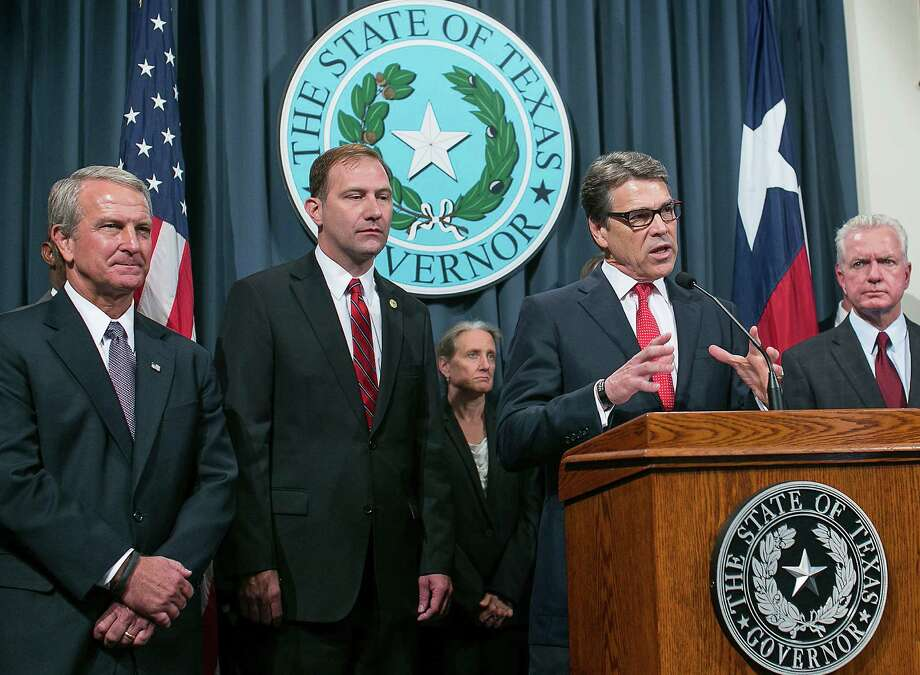 Gov. Rick Perry's Ebola task force calls for contingency plans in unlikely event of a widespread outbreak of the disease. Photo: Rodolfo Gonzalez, MBO / Austin American-Statesman