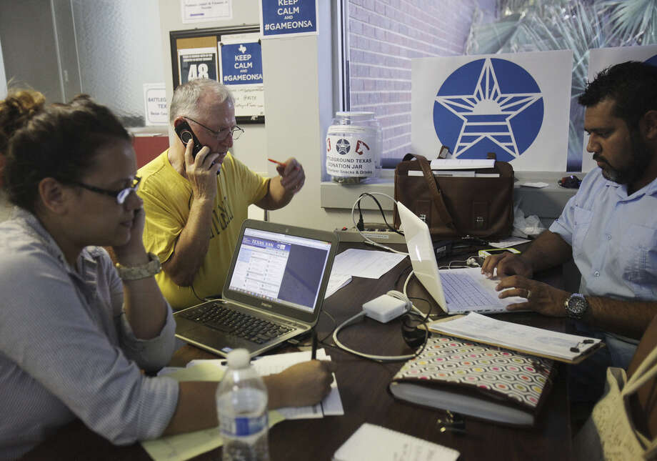 People with Battleground Texas work the phones at the Bexar County Democratic Party headquarters in July 2013. The group is hoping new voters make the difference this year. Photo: San Antonio Express-News File Photo / © San Antonio Express-News