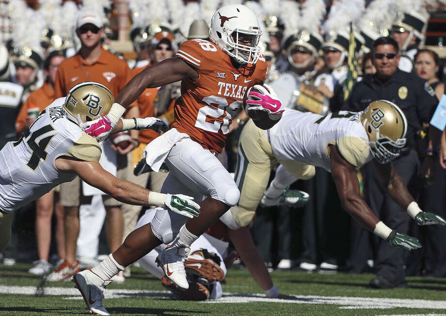 Longhorns senior running back Malcolm Brown says the last time he was on a team that felt unbeatable wasn't with Texas — it was with the Steele Knights. Photo: TOM REEL