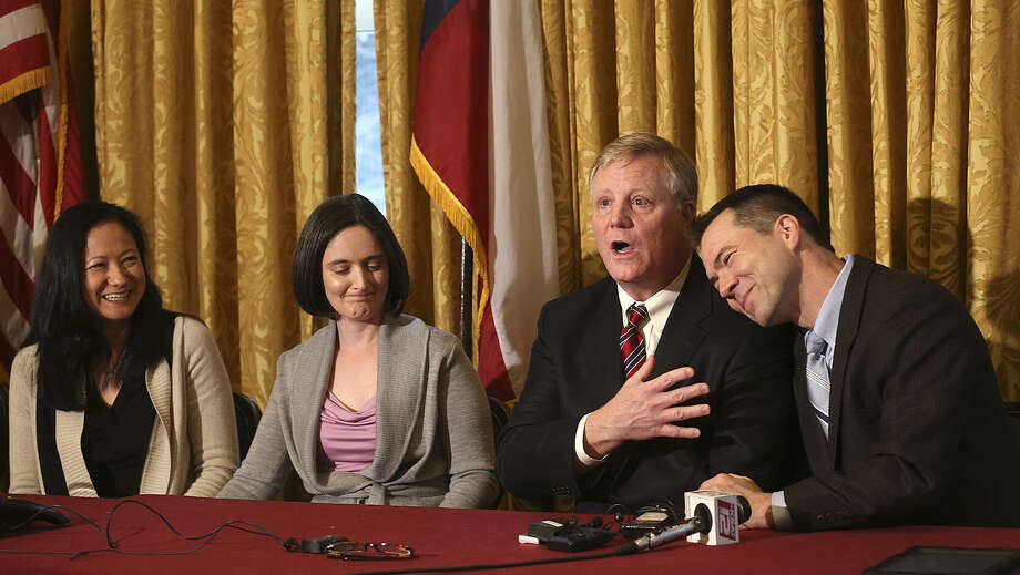 Same-sex couples and ex-San Antonians Cleopatra De Leon (from left), Nicole Dimetman, Mark Phariss and Victor Holmes sued the state of Texas over its ban on same-sex marriage. A federal judge ruled in their favor, but the state has appealed the decision. Photo: San Antonio Express-News File Photo / ©2013 San Antonio Express-News