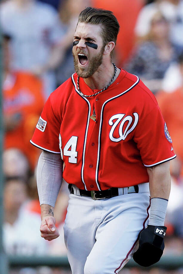 Bryce Harper lets loose after a throwing error by Madison Bumgarner in the seventh inning. Harper added an insurance run with a homer in the ninth. Photo: Ezra Shaw, Staff / 2014 Getty Images