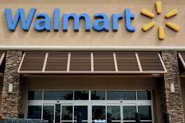 Wal-Mart plans to work with DirectHealth.com to allow shoppers to compare coverage options and enroll in Medicare plans or public exchange plans.