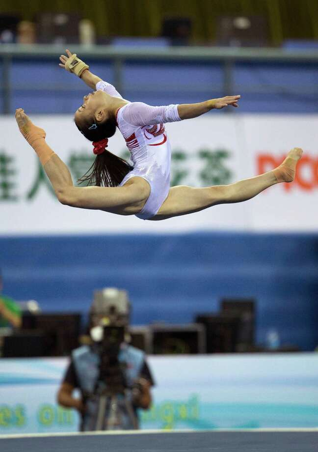China's Tan Jiaxin performs her floor exercise during the women's qualifying round of the Artistic Gymnastics World Championships at the Guangxi Gymnasium in Nanning, capital of southwest China's Guangxi Zhuang Autonomous Region Monday, Oct. 6, 2014.  Photo: Andy Wong, Associated Press / AP