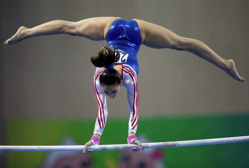 Malaysias FARAH ANN Abdul Hadi competes on the uneven bars during.