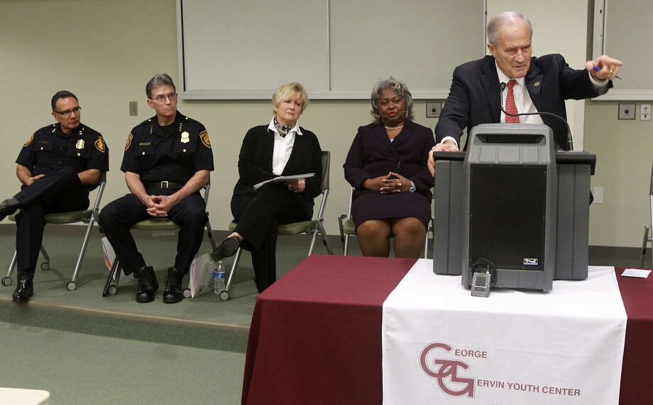 Bexar County Commission-er Tommy Adkisson (right, at lect-ern) speaks about the  George Ger-vin Youth Center and its clients. Among the guests were Chief of Police William Mc-Manus (second from left) and, next to Mc-Manus,  Bexar County DA Susan Reed. Photo: John Davenport / San Antonio Express-News / ©San Antonio Express-News/John Davenport