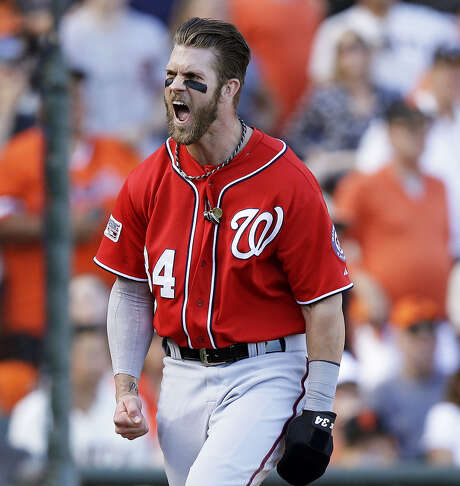 The Nationals' Bryce Harper exults after scoring on a throwing error by Madison Bumgarner during the seventh inning Monday. Harper added a solo home run in the ninth as Washington forced a Game 4 today. Photo: Ezra Shaw / Getty Images / 2014 Getty Images
