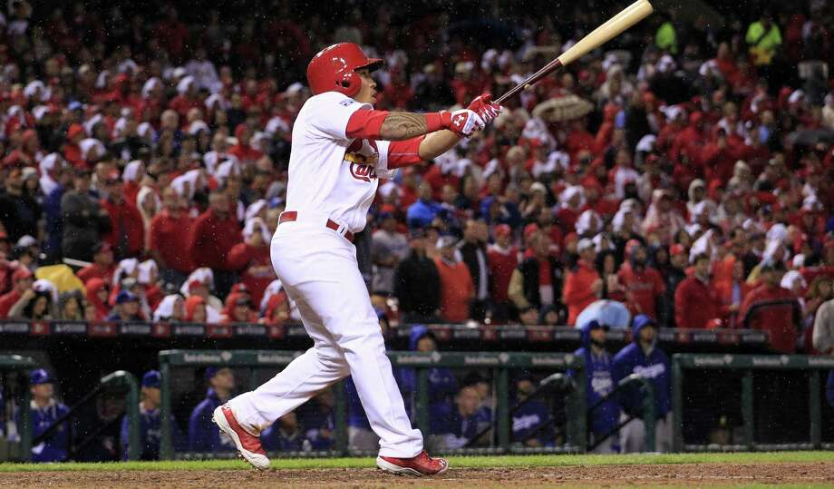 Kolten Wong hits a two-run homer in the seventh that broke a 1-1 tie and gave the Cardinals a 2-1 lead in the best-of-5 series with the Dodgers on Monday. Photo: Jeff Roberson / Associated Press / AP