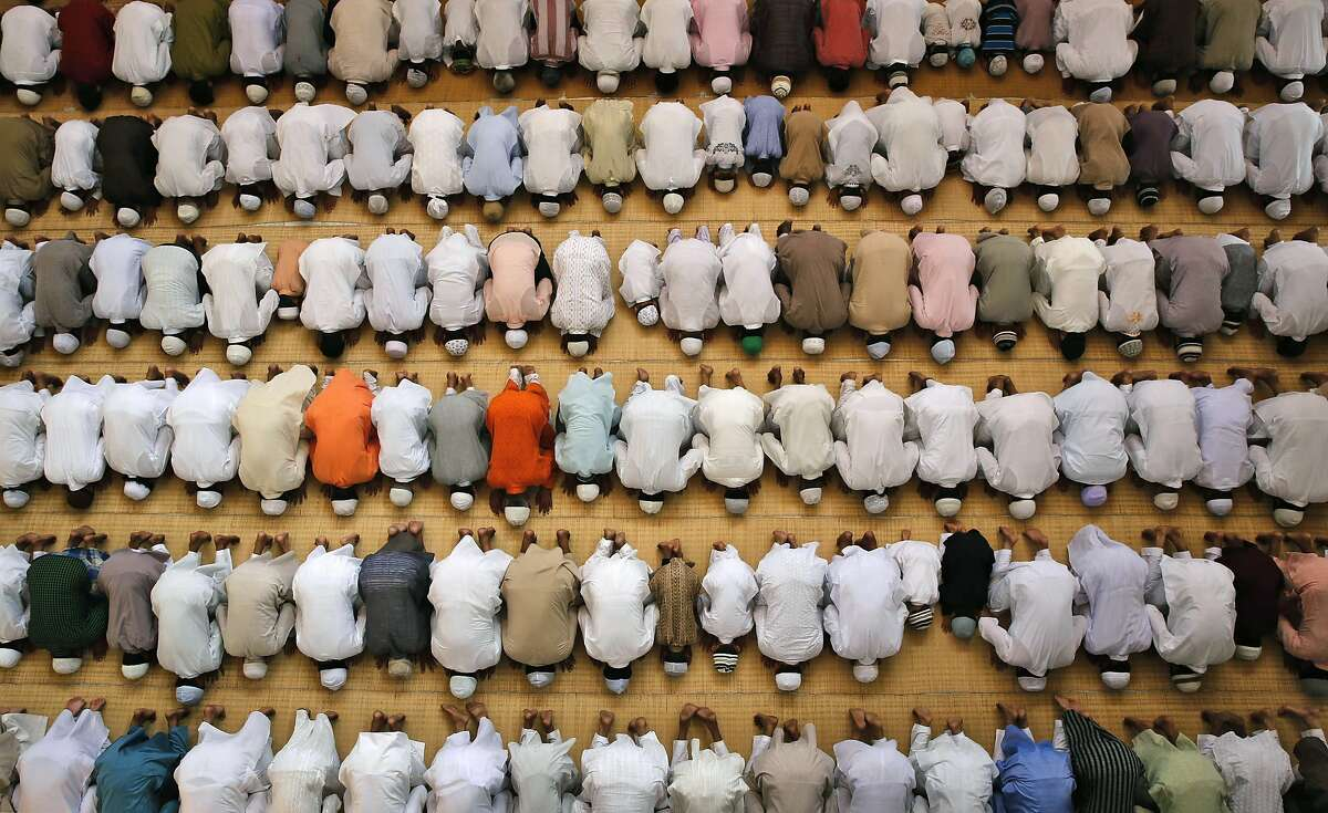 Indian Muslims offer prayers during Eid al-Adha at the Vasi Ullah mosque in Allahabad, India, Monday, Oct. 6, 2014. Eid al-Adha is a religious festival celebrated by Muslims worldwide to commemorate the willingness of Prophet Ibrahim to sacrifice his son as an act of obedience to God. (AP Photo/Rajesh Kumar Singh)