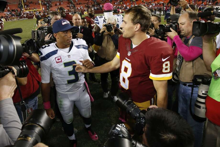 Seattle Seahawks quarterback Russell Wilson (3) and Washington Redskins quarterback Kirk Cousins (8) talk after an NFL football game in Landover, Md., Monday, Oct. 6, 2014. Seattle defeated Washington 27-17. (AP Photo/Alex Brandon) Photo: AP