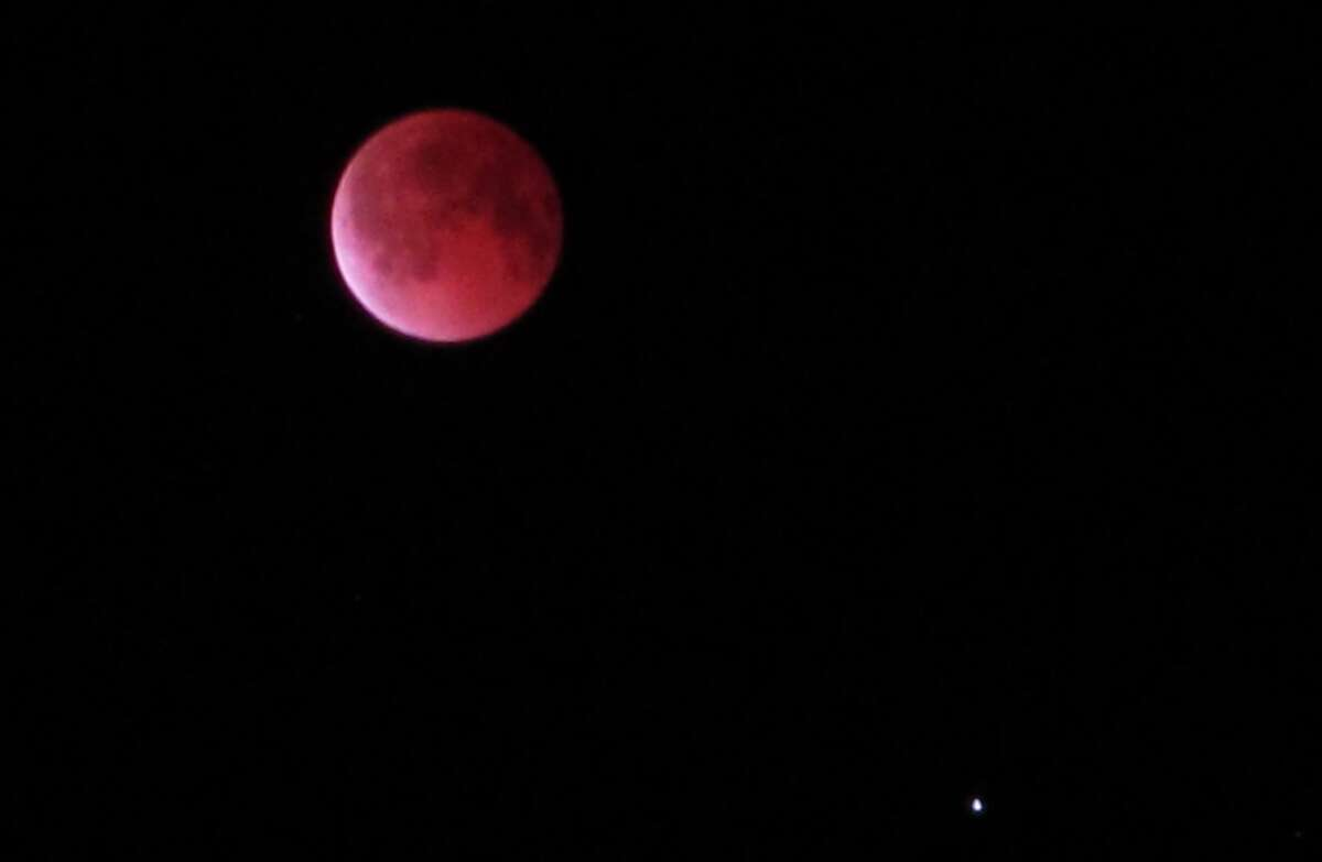 The blood moon is seen from Pearland, Texas, Tuesday, April 15, 2014.