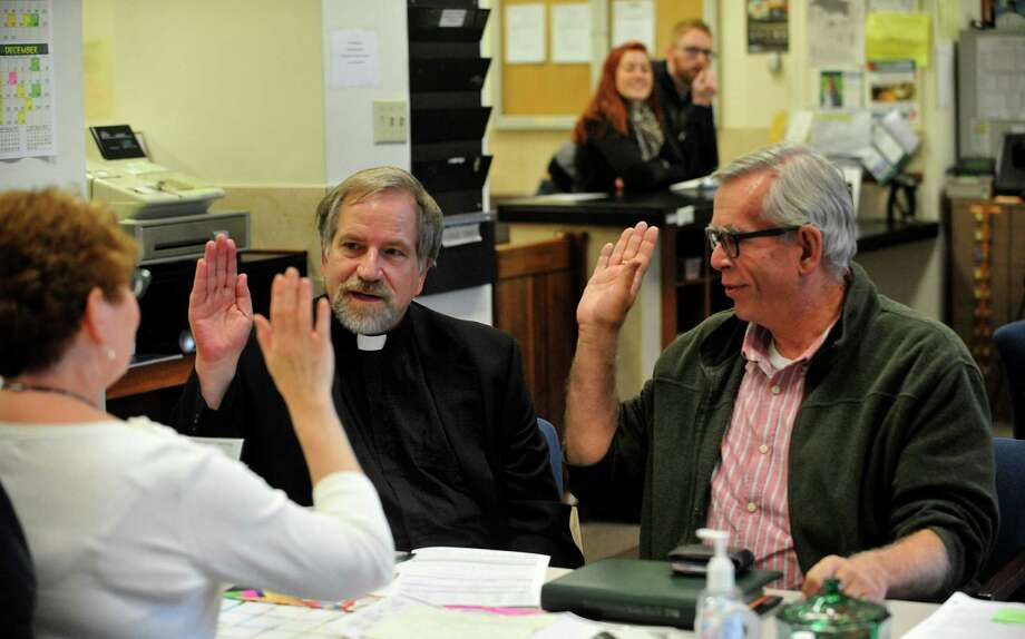 Tony Larsen, 65, pastor at Olympia Brown Unitarian Universalist Church, left, and partner Craig Matheus, 62, verify their vital information with Joanne Smith, deputy clerk as they apply for a marriage license on Monday, Oct. 6, 2014 in the County Clerk's office inside the Racine County Courthouse in Racine, Wis. The Racine County Clerk's office began taking applications for marriage licenses at about noon Monday after the U.S. Supreme Court rejected the appeal of a lower court ruling. Photo: Scott Anderson, AP / The Journal Times