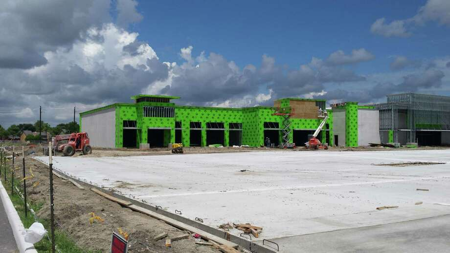 A new strip center is going up near H-E-B on Pearland Parkway.