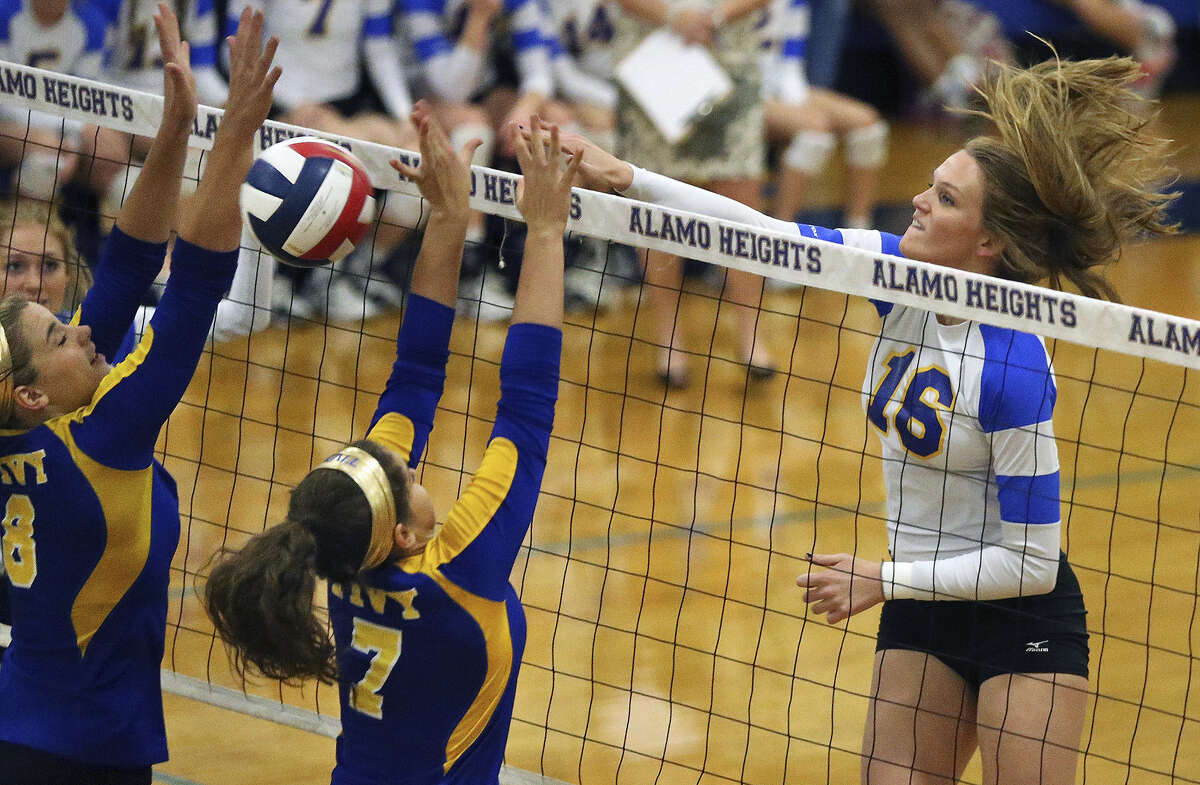 Alamo Heights middle blocker Callie Cook jams the ball over the net as the Mules host Kerrville Tivy Sept. 30 at the Alamo Heights gym.