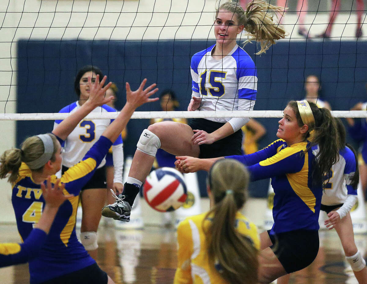 Lady Mule McKay Kyle enjoys the scramble on the other side of the net after her shot as Alamo Heights hosts Tivy at the Alamo Heights Gym on September 30, 2014.