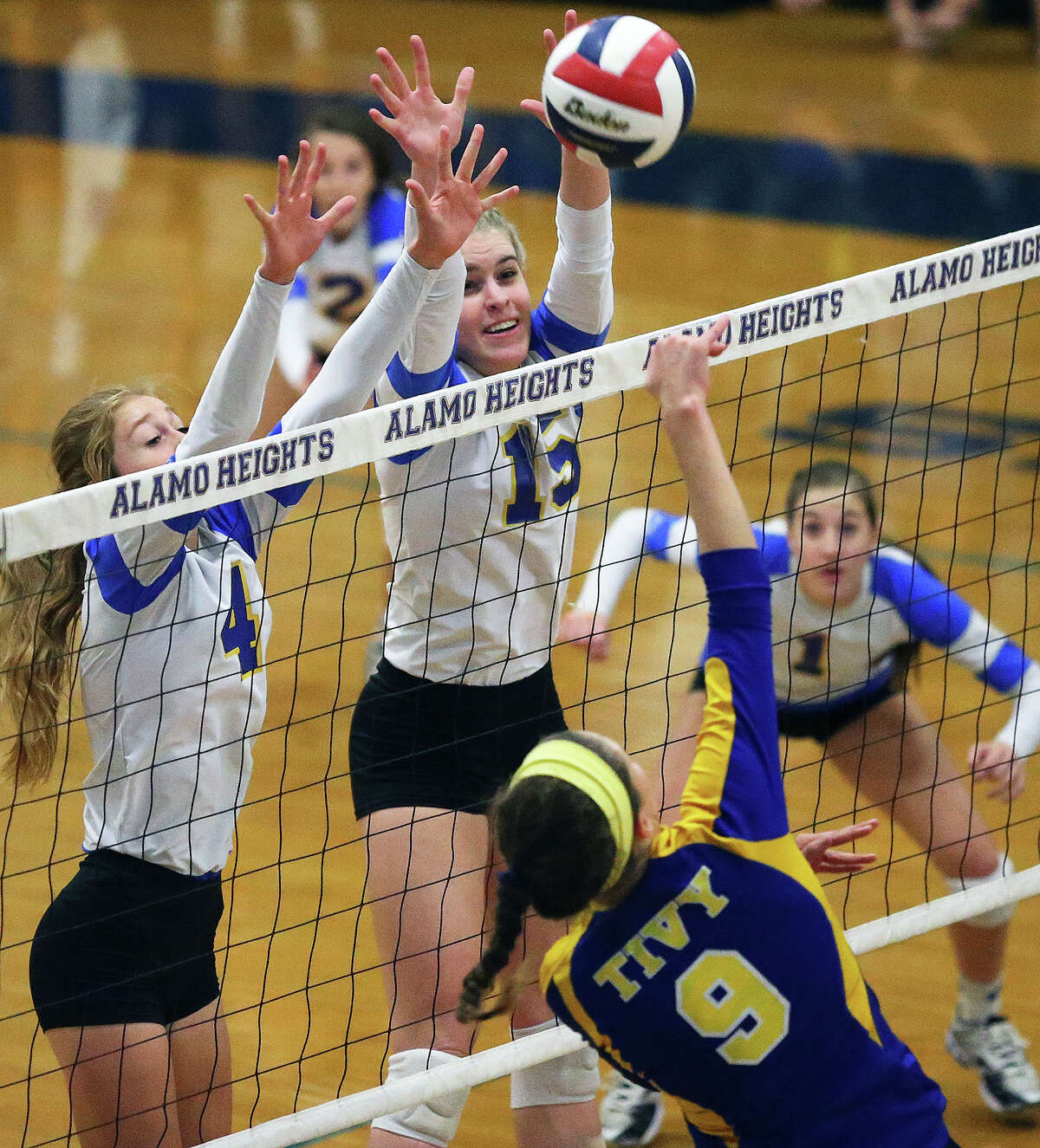 Lady Mules Taylor Whitlock (4) and McKay Kyle get up to block a shot by Kendall Bosse Alamo Heights hosts Tivy at the Alamo Heights Gym on September 30, 2014.