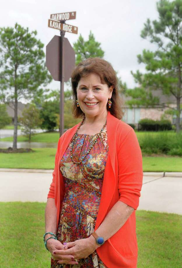 Susan Vreeland-Wendt stands by two of the streets she named in The Woodlands. She named more than 1,600 streets in the community as part of her job with The Woodlands Development Co. Photo: David Hopper, Freelance / freelance