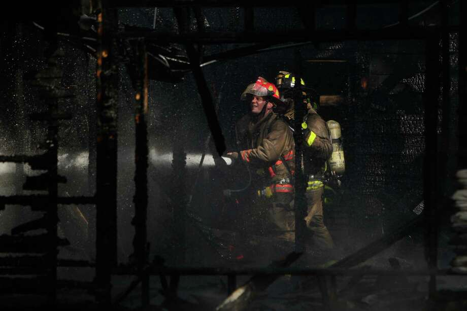 Houston firefighters battle a pair of house fires on Oats and Sumper on Oct. 7, 2014. Photo: Mayra Beltran | Houston Chronicle