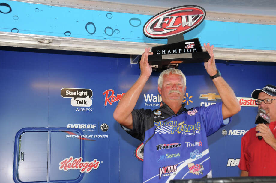 Albert Collins of Nacogdoches, Texas, takes home the trophy for winning the Rayovac FLW Series event on Rayburn Reservoir. (Photo by Rob Newell)