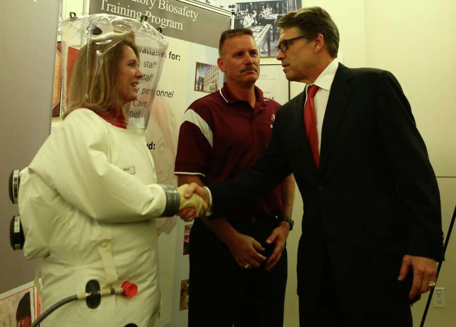 Rick Perry visited UTMB in Galveston, Tuesday, Oct. 7, 2014. A patient in Dallas was diagnosed with Ebola, leading to fears that the deadly disease could spread in Texas and around the United States. Photo: Marie D. DeJesus / Houston Chronicle